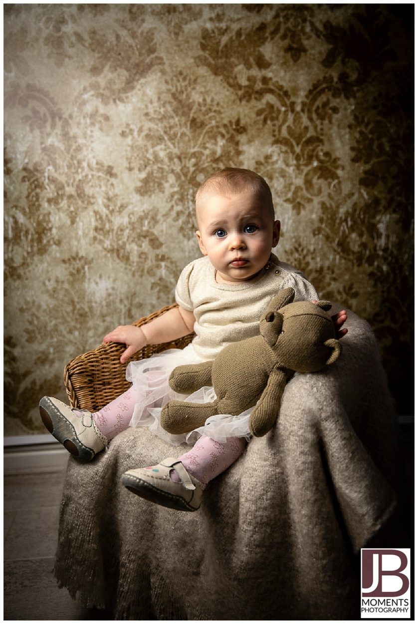 Mid key, muted tones, little girl captured by JB Moments Photography